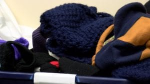 Hats and Scarfs in Bin for Catholic Charities