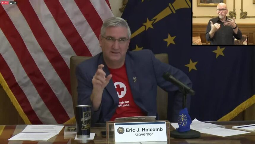 Holcomb in red cross tshirt