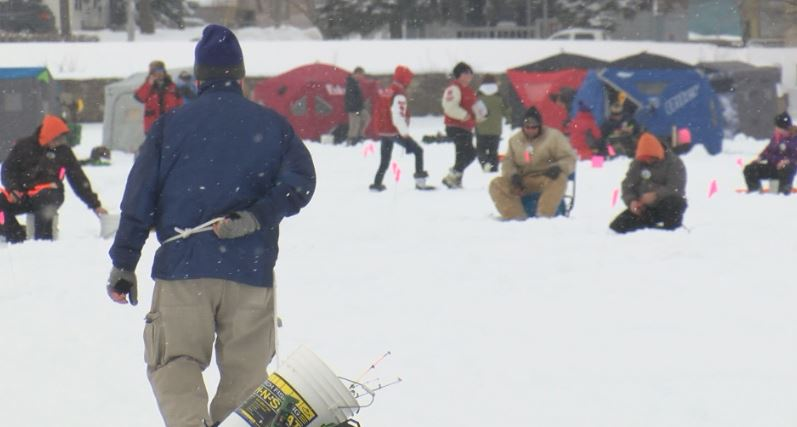 Ice fishing on Austin's East Side Lake