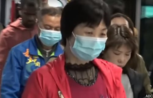 Woman wearing mask after outbreak in China