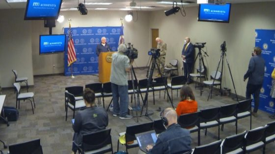 Gov. Walz and gathered officials at state emergency operations center