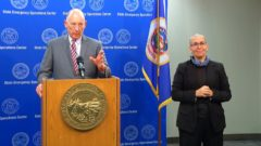 Commissioner Paul Schnell and sign language interpreter