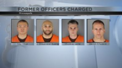 four officers charged