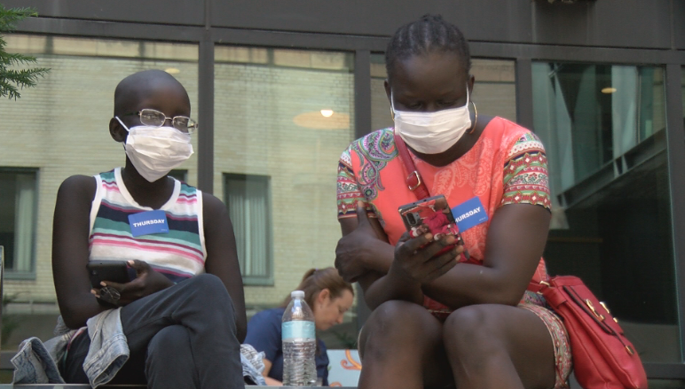 People wearing masks in downtown Rochester