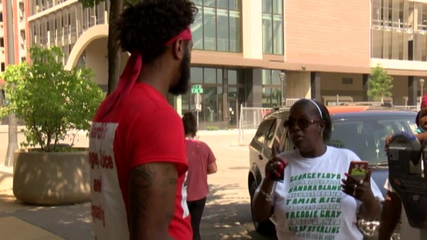 Terry Willis talks to Rochester residents downtown