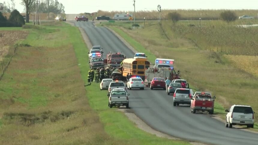 Emergency responders at crash scene involving school bus