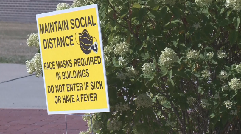 Sign in Iowa reminding residents about health guidelines