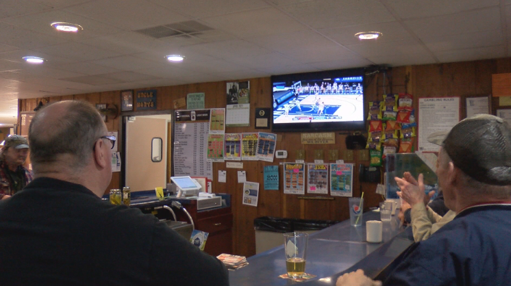 Hayfield residents watch basketball at Uncle Mony's
