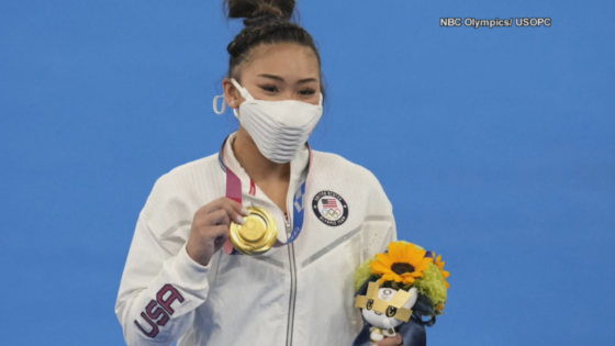SUNI LEE WITH GOLD MEDAL