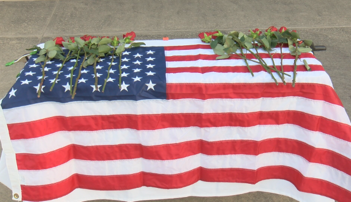 13 roses on American Flag