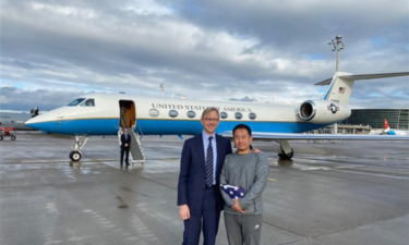 From left, U.S. Special Representative Brian Hook stands next to freed U.S. prisoner Xiyue Wang, who has been held in Iran for 3 years. - State Department