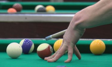 Pool player lines up shot