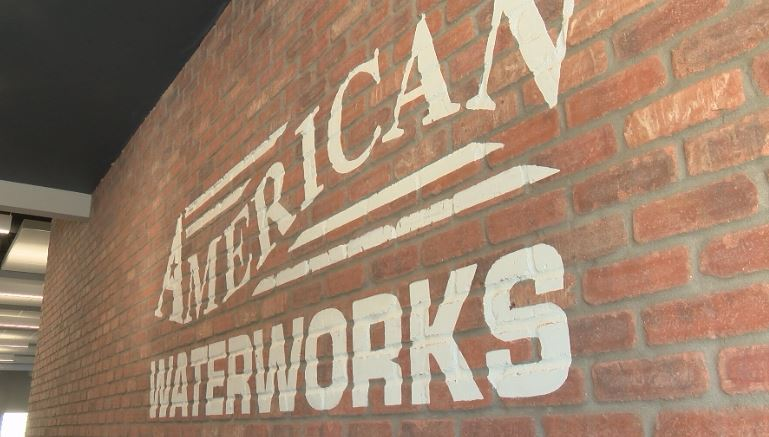 American Waterworks painted on brick wall