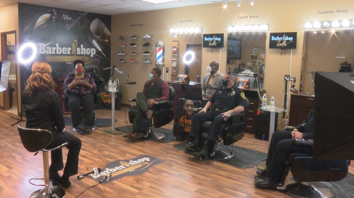 Barbershop Talk discussion between law enforcement officers and Rochester residents