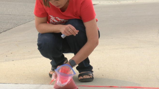 Pouring Red Sand