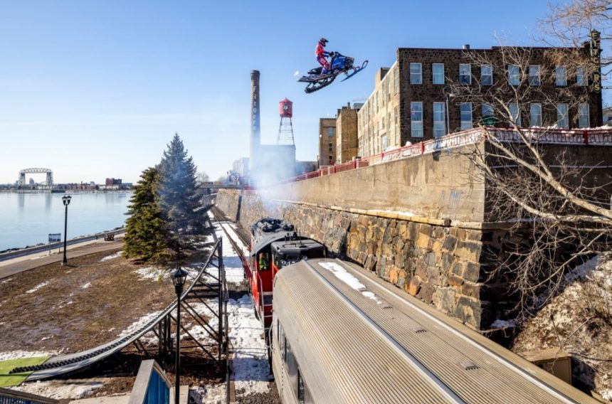 WATCH: Stunt rider flips and flies through downtown Duluth on snowmobile