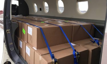 Election supplies being delivered by state planes ahead of Wisconsin's April 7 election. Wisconsin Dept. of Administration photo.