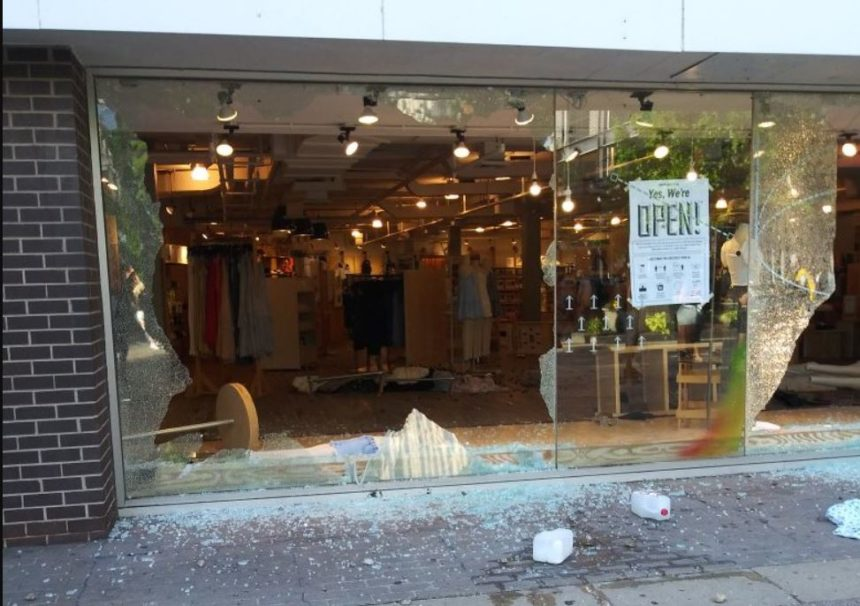A storefront on State Street in Madison was smashed as a protest over the killing of George Smith turned violent