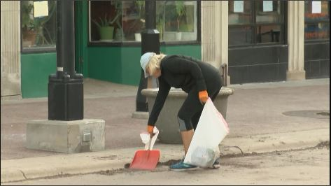 Residents volunteer to clean up State Street Sunday morning following a night of unrest.