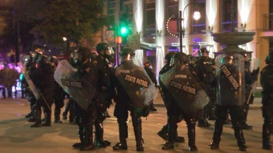 Members of the Wisconsin State Patrol work to control crowds in downtown Madison May 31, 2020. WKOW photo