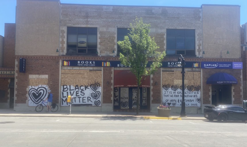 Murals have been painted on boarded up store fronts on State Street. Photos by Ashlee Yilmaz