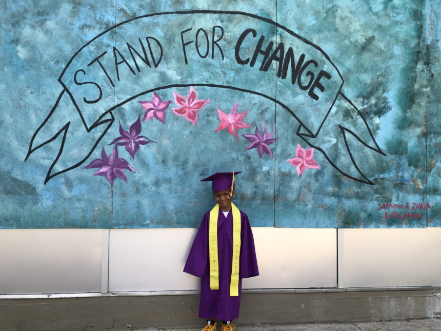 Trenton, 5, is graduating from an east side preschool. His mother, an educator, wanted to get some photos to mark these historic times. Photo courtesy Julie David.