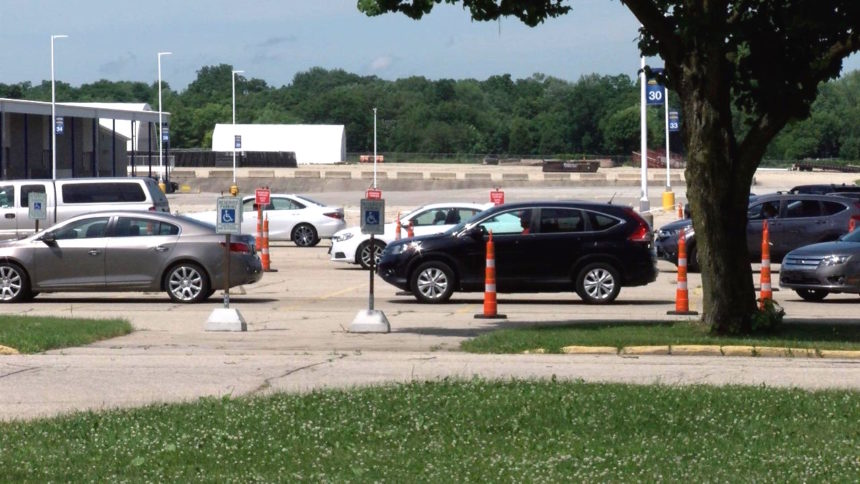 Cars line up Tuesday for COVID-19 testing at the Alliant Energy Center in Madison.