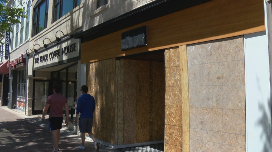 A shop is boarded up on State Street after a night of unrest.