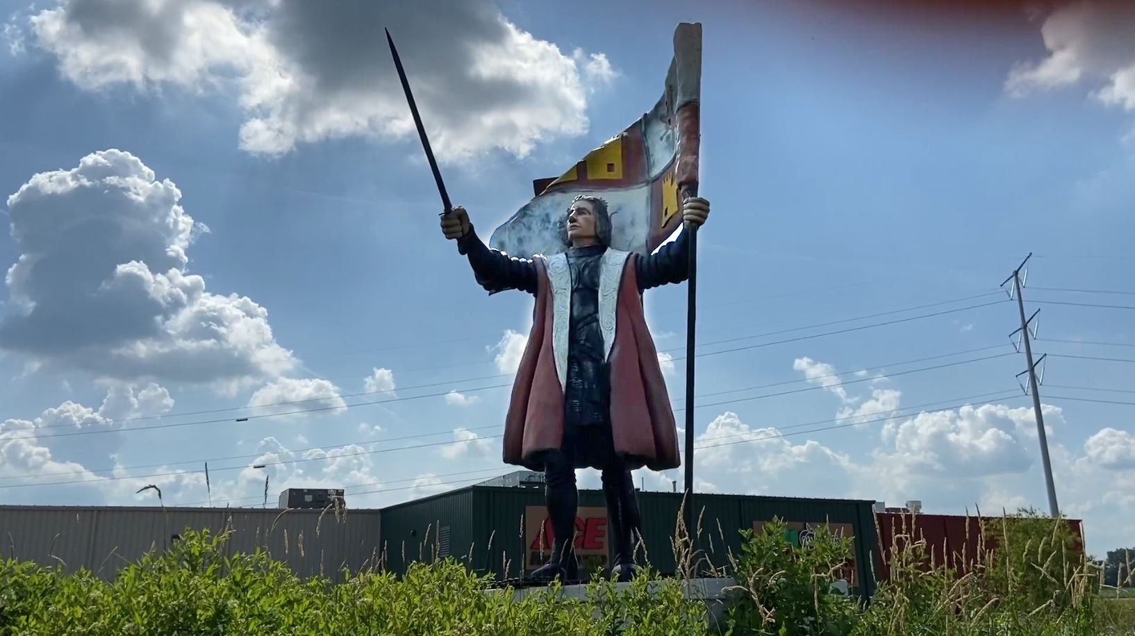 A statue of Christopher Columbus sits outside of the city of Columbus, Wisconsin, in July of 2020.