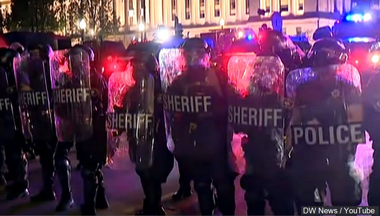 Sheriff's deputies respond to protests during a night of civil unrest in Kenosha.
