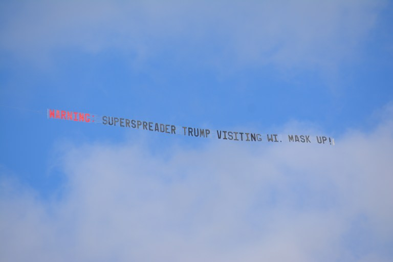 Airplane banner warns of the potential superspreader event prior to Trump's rally