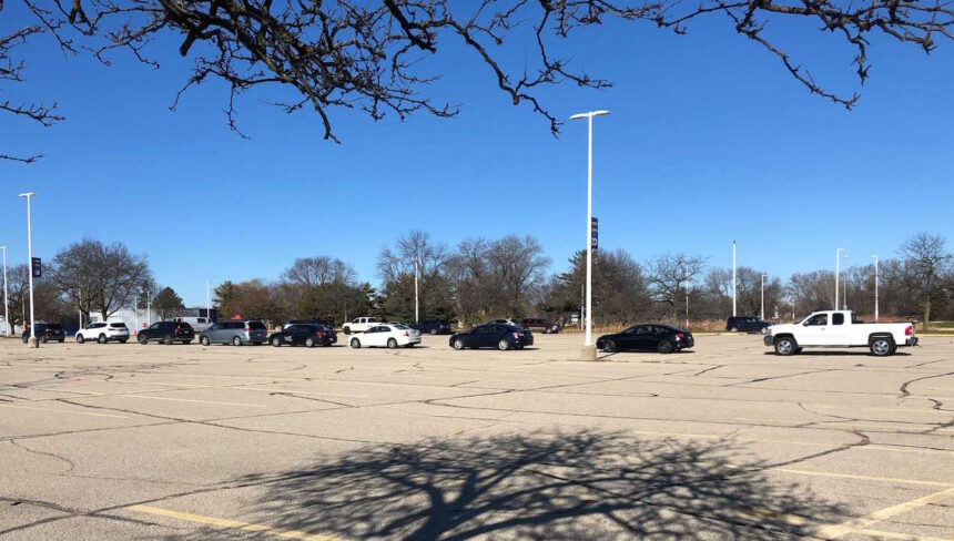 Cars line up for COVID-19 testing Dec. 1, 2020 at the Alliant Energy Center in Madison.