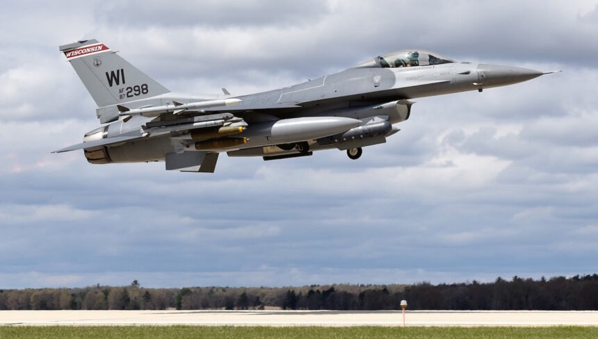 An F-16 Fighting Falcon assigned to the Wisconsin Air National Guard's 115th Fighter Wing takes off from the Truax Field Air National Guard Base in Madison.