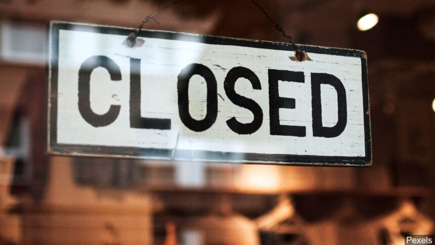 A closed sign hangs in a window.